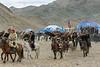 Parade of eagle hunters, Eagle Festival, Olgii, Western Mongolia