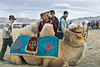 Beautiful blond Bactrian camel and proud owner, Eagle Festival, Olgii, Western Mongolia