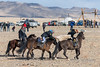 Competitors and referee at the Kukhbar competition, Eagle Festival, Olgii, Western Mongolia