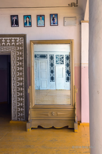 Interior of Soviet-built neo-classicl theater, Khovd, Western Mongolia<br /> <br /> The messy 'communist' yellow paint job on the floor seems to have spilled over onto the bottom of the mirror..