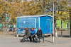"""Three men on a bench<br /> <br /> Main square of the Soviet-era town of Khovd, Western Mongolia.  The bright blue closed Coca Cola stand was quite eye catching<br /> <br /> 02/09/15  <a href=""""http://www.allenfotowild.com"""">http://www.allenfotowild.com</a>"""