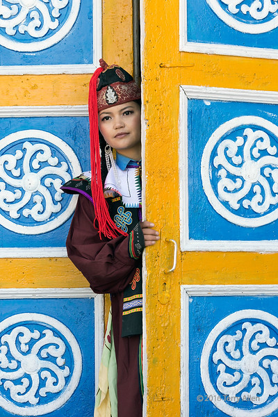 """Kazakh woman wearing traditional attire.<br /> <br /> Taken in Khovd (Hovd), Western Mongolia at the town theater with its interesting decorated doors.  Khovd is at the foot of the Altai mountains near the northern border with China.<br /> <br /> Photographing people in remote areas is one of the joys of travel. Today I have posted a number of people pics here: <a href=""""http://goo.gl/zU4mgP"""">http://goo.gl/zU4mgP</a><br /> <br /> 25/02/15  <a href=""""http://www.allenfotowild.com"""">http://www.allenfotowild.com</a>"""