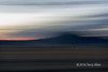 """Car lights at dawn (best larger)<br /> <br /> I was out on the steppes near the Mongol Altay Mountains to take a sunrise shot with my camera on a tripod when I noticed distant car lights bouncing over a dirt road across the steppes. I panned the camera on the tripod with movement of the lights and managed to capture the car lights sharply while blurring the scenery. This is another one that belongs to my experiments with in camera effects.<br /> <br /> Other photos taken the same morning can be seen here: <a href=""""http://goo.gl/tGvlIA"""">http://goo.gl/tGvlIA</a><br /> <br /> 17/08/15  <a href=""""http://www.allenfotowild.com"""">http://www.allenfotowild.com</a>"""