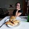 Emilie smiles at the sight of her first khushuurs (Mongolian meat pies)