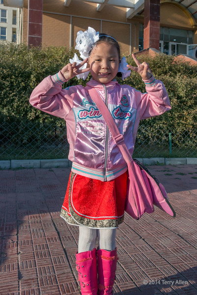 """Young girl, Ulaanbaatar<br /> <br /> I was walking along a street in Ulaanbaatar, Mongolia yesterday when I felt a tug on my sleeve and this small girl, who seemed to be dressed up for a party, wanted me to take her picture. I was happy to oblige.<br /> <br /> 30/09/14  <a href=""""http://www.allenfotowild.com"""">http://www.allenfotowild.com</a>"""