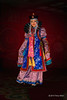 """Mongolian singer in traditional dress<br /> <br /> I went to a performance of traditional Mongolian entertainment in Ulaanbaatar and paid the camera fee so I could take some pictures of the colourful performers.  Their costumes were spectacular!<br /> <br /> John Owen asked about the long sleeves, and I noticed the same thing in other women's costumes during the performance and during my visit to a traditional costume shop, so it is a cultural tradition. I found a reference to their practical use to keep their hands warm in the winter like the Western muff, and to function as 'gloves' to pick up very cold objects such as chunks of ice.  The tapered turned back cuffs are supposed to represent horses hooves.<br /> <br /> I had to spend a day in Beijing due to flight delays and found that large segments of the internet appear to be 'embargoed', so glad to be home where I have normal access.<br /> <br /> 10/10/14  <a href=""""http://www.allenfotowild.com"""">http://www.allenfotowild.com</a>"""