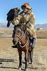 Kazakh eagle hunter with eagle and horse #3, Western Mongolia (best larger)