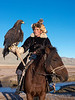 """Portrait of a Kazakh eagle hunter, his golden eagle and his horse (best larger)<br /> <br /> The Kazakh hunters use the eagle to hunt fox and rabbits for their furs, which they wear, and to supplement their meagre diet in the winter.  The people of the steppes of Western Mongolia are primarily herdsmen of goats, sheep, yaks, bactrian camels and horses and their diet is very high in meat and fermented milk, with some noodles, but few vegetables.<br /> <br /> 12/10/14  <a href=""""http://www.allenfotowild.com"""">http://www.allenfotowild.com</a>"""