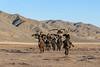 Five Kazakh eagle hunters riding on the steppes, Western Mongolia