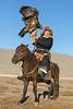 Elder Kazakh eagle hunter posing on the steppes.