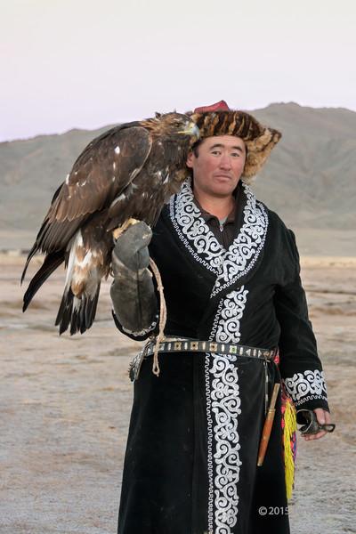 Kazakh eagle trainer with his eagle, Western Mongolia