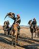 Three Kazakh eagle hunters with their eagles