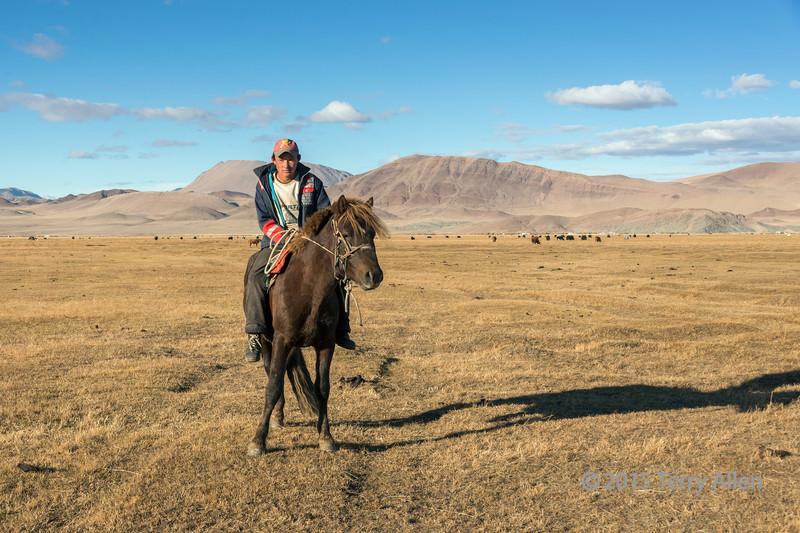 Mounted Mongolian goat herder, near Olgii, Western Mongolia