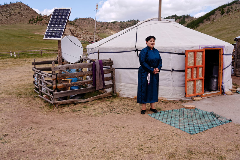 A woman, known for her cheese making, outside her ger, the traditional home in Mongolia.