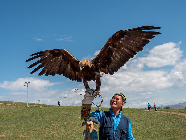 Kazakh man with golden eagle