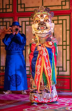 Tumen Ekh masked figure