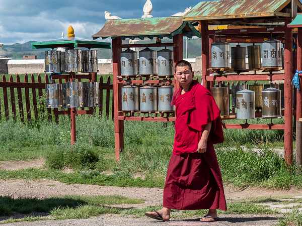 Monk and prayer wheels