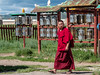 Monk and prayer wheels