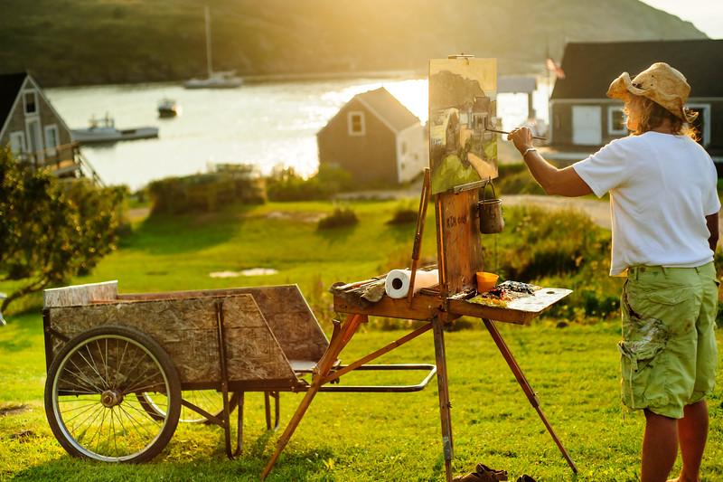 Artists capturing the mellow mood of Monhegan Harbor at sunset