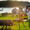 Painter Capturing Monhegan Harbor at Sunset