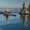 Reflections of tufas on Mono Lake.