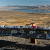 A gallery of stickers on a US Highway 395 guardrail overlooking Mono Lake.