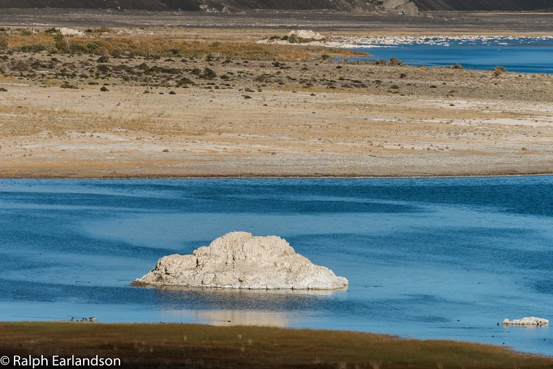 A dome of white tufa on Mono Lake's blue water.