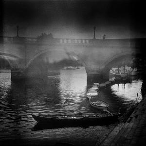 Rowing boats and Richmond Bridge, Surrey, England