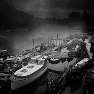 Boats moored at riverside of Richmond upton Thames