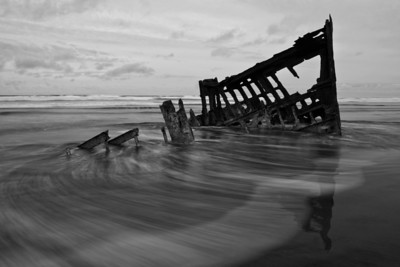 My favorite of the Peter Iredale images.  It was just before sunset, I was shooting with a polarizer and an 8X ND filter, tripod and remote.  I took a few exposures letting the freezing cold Pacific Ocean wash over my feet in hopes of getting the right patterns in the water.  You actually have to lift your feet over and over again, or you start to sink in the sand.