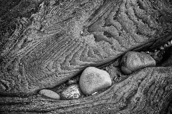 Rocks in driftwood