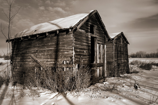 Old, snowy abandoned farm buildings