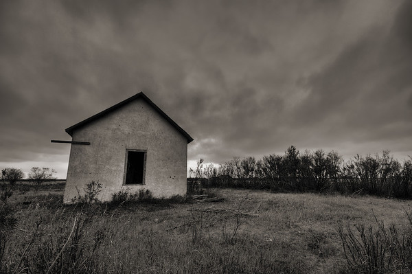 Abandoned and leaning old farm building