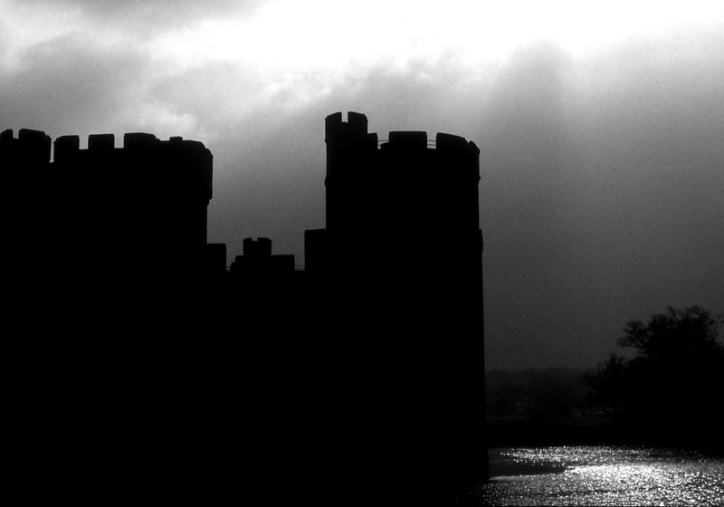 Sun momentarily breaks through the clouds above Bodiam Castle, East Sussex.