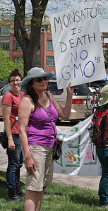 Protester with anti-GMO and Monsanto sign.