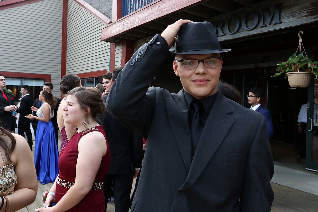 . Montachusett Regional Vocational Technical School had their prom at Wachusett Mountain in Princeton on Friday night, May 11, 2018. Student Alex Meuer from Gardner rocks a hat at the prom. SENTINEL & ENTERPRISE/JOHN LOVE