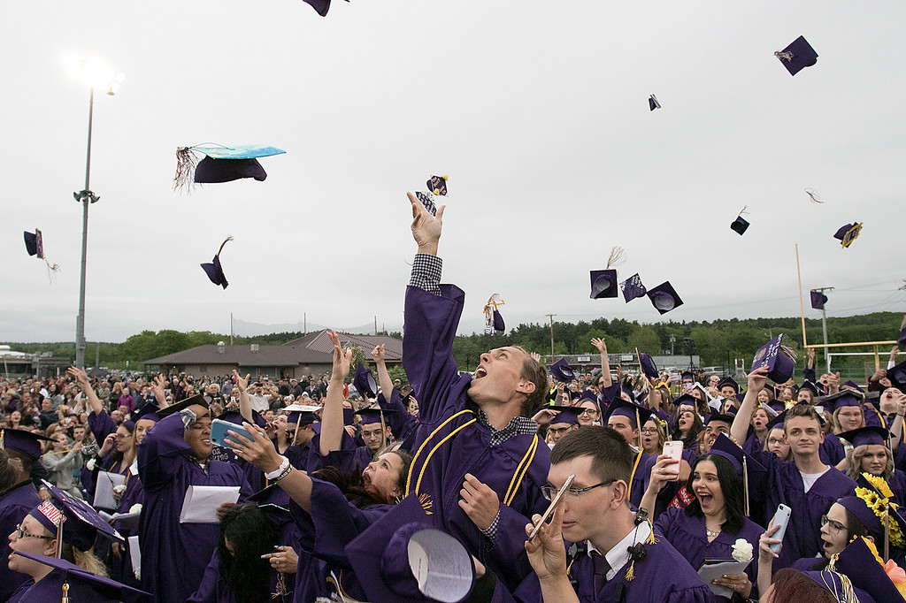 . John Kelley III throws his cap into the air at the end of the Montachusett Regional Vocational Technical School\'s graduation ceremony on Wednesday night, May 29, 2019. SENTINEL & ENTERPRISE/JOHN LOVE