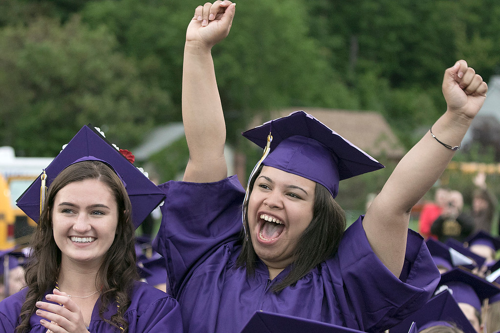 . Natalie Manzueta cheers for a fellow student during the Montachusett Regional Vocational Technical School\'s graduation ceremony on Wednesday night, May 29, 2019. Next to her is fellow student Jordin LeBouf. SENTINEL & ENTERPRISE/JOHN LOVE