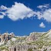 Dolomiti di Sesto.<br /> A sinistra: il monte Rudo, la Croda dei Rondoi dietro le Cime Bulla.<br /> A destra: Il rifugio Locatelli posto sulla forcella di Toblin, tra la Torre di Toblin-Sasso di Sesto (dietro il rifugio) e il Paternkofel/Monte Paterno (le cui pendici si vedono a destra di questa panoramica).<br /> <br /> Foto n° 060809-466680 - 177 x 47 cm @ 300dpi