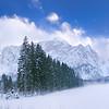 Mangart nebbioso dalla conca dei laghi di Fusine - foto n° 130216-35013665