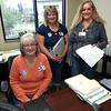 Park Side lending staff (Lorie Willard, Karen Cowan, and Connie Whittaker) sifting through files on Miracle Jeans Day. They brought it local with a Shodair Children's Hospital badge featuring Landen, Montana's 2013 CMN Miracle Child.