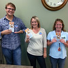 Park Side FCU's Whitefish Teller staff (Zach Bigoness-Malloy, Samantha McGillis, and Sharon Williams) support Miracle Jeans Day with gusto well into the afternoon, proudly offering information on the Shodair Hospital fundraiser.