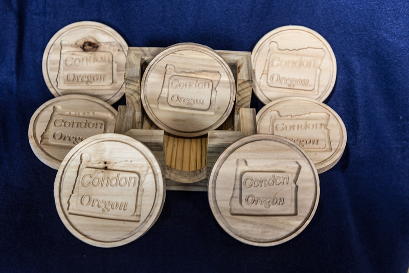 #300: 7 Coasters with Blue stained pine holder ($40)