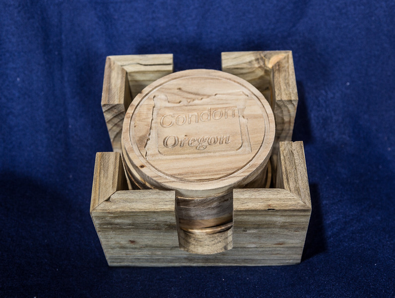 #300: 7 Coasters with Blue stained pine holder ($35)