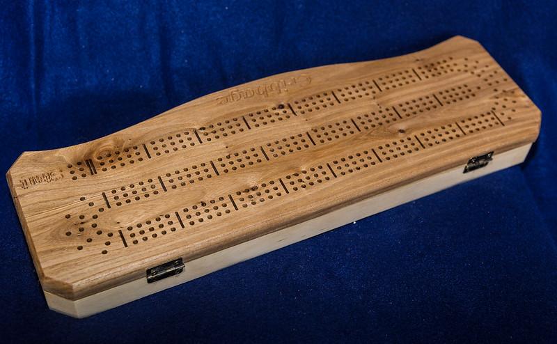 Item #100 Curved Elm & Spruce Cribbage Board $50