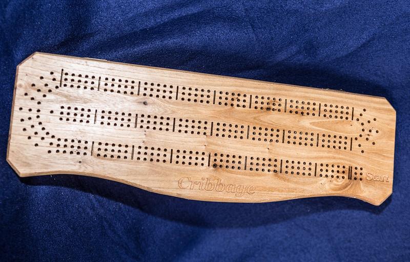 Item #:100 Curved Elm & Spruce Cribbage Board $50