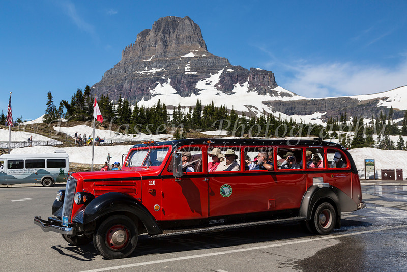 A tourist Red Bus and Clements Mountain at Logan Pass in Glacier National Park, Montana, USA.