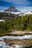 Alpine scenery with Mount Reynolds and  waterfall near Logan Pass in Glacier National Park, Montana, USA.