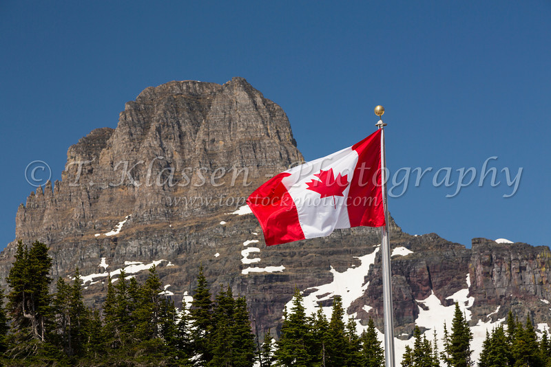 The Canadian flag and Clements Mountain at Logan Pass in Glacier National Park, Montana, USA.