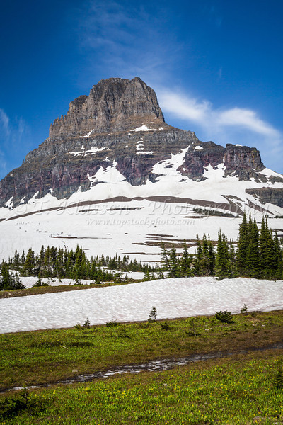 Alpine scenery with snow and Clements Mountain near Logan Pass in Glacier National Park, Montana, USA.